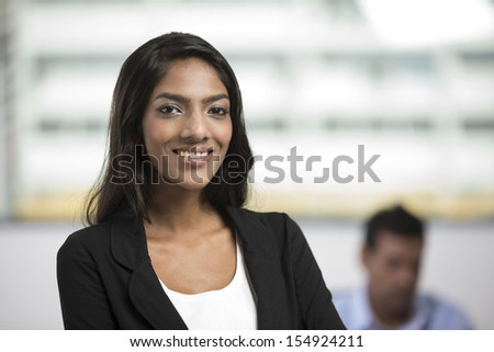 Portrait of an Indian female office executive standing in an office.