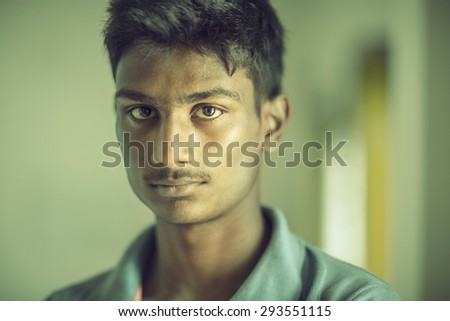 Portrait of an Indian Teen Boy looking at the camera - stock photo