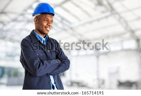 Portrait of an industrial worker in a bright environment - stock photo