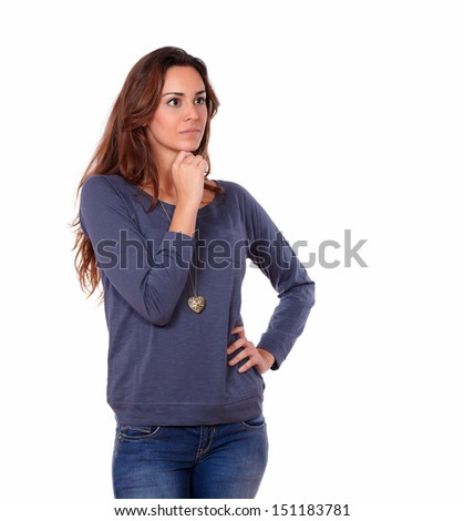 Portrait of an interested latin young woman reflecting alone while standing on white background - copyspace - stock photo