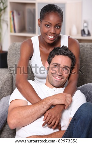 Portrait of an interracial couple - stock photo
