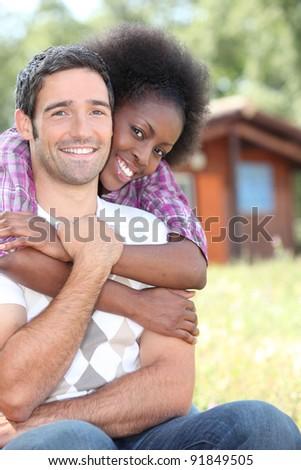 Portrait of an interracial couple - stock photo