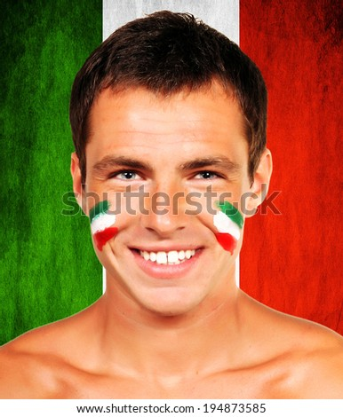Portrait of an italian soccer fan over italy flag background - stock photo