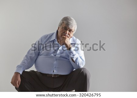 Portrait of an obese old man - stock photo