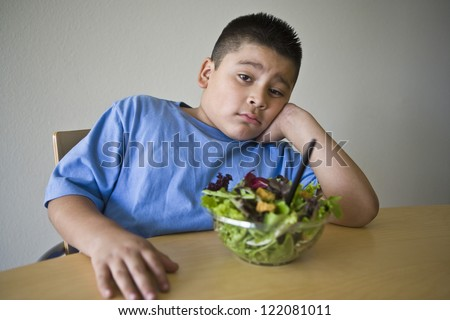 Portrait of an obese preteen boy on a diet - stock photo