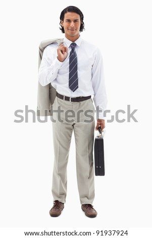 Portrait of an office worker holding his jacket over his shoulder and a briefcase against a white background