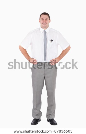 Portrait of an office worker with the hands on his hips against a white background