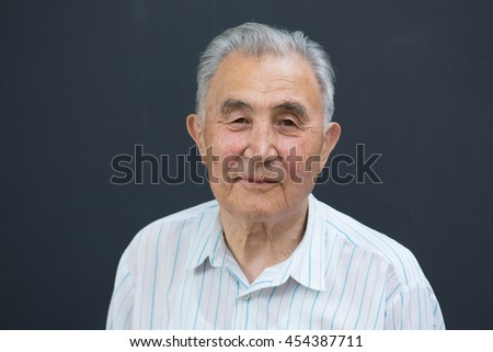 Portrait of an old Asian man in the studio