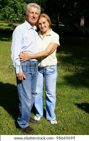 portrait of an old couple at park - stock photo