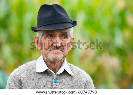 Portrait of an old farmer outdoor