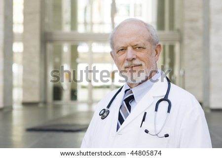 Portrait of an Old Male Doctor with a Stethoscope around His Neck - stock photo