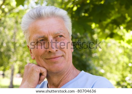 portrait of an old man in a park