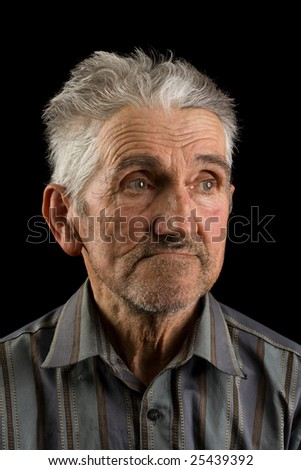 Portrait of an old man isolated on black - stock photo