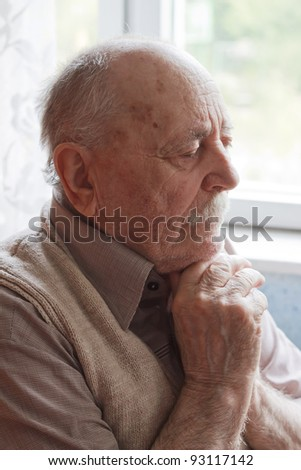 portrait of an old man thinking - stock photo