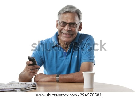 Portrait of an old man with a mobile phone - stock photo