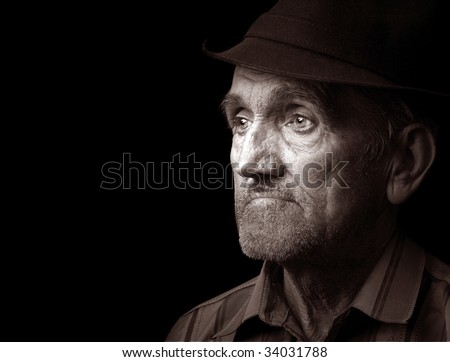 Portrait of an old man with hat, isolated on black - stock photo
