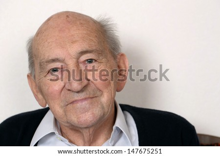 Portrait of an old senior man with copy space