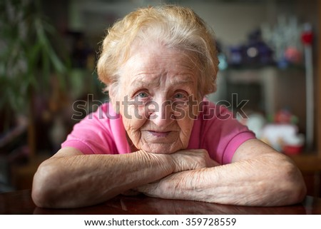 Portrait of an old woman close-up. - stock photo