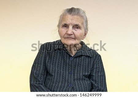 Portrait of an old woman. Dreaming the past. - stock photo