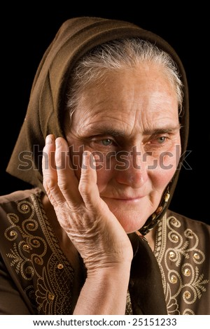Portrait of an old woman in thoughts - stock photo