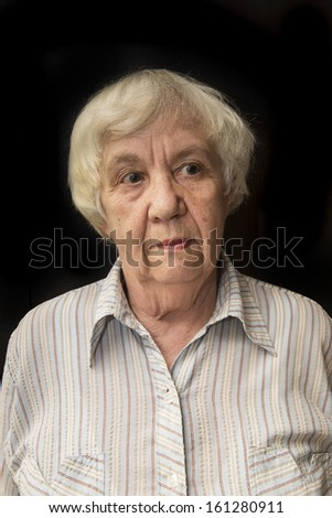 Portrait of an old woman. Real people series. - stock photo