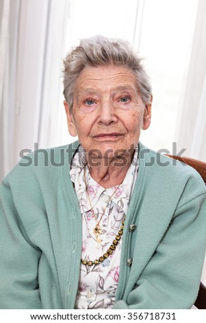 portrait of an old woman sitting