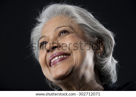 Portrait of an old woman smiling - stock photo