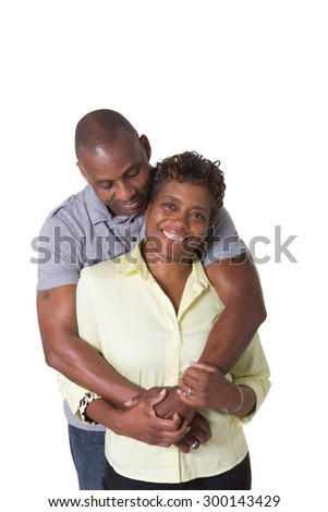 Portrait of an older couple facing embracing, isolated