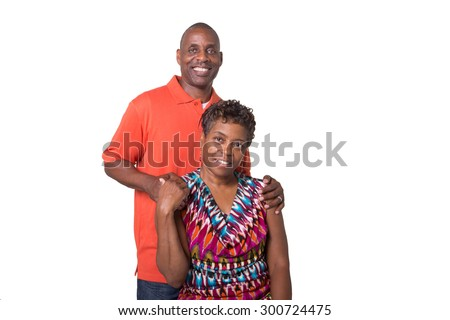 Portrait of an older couple standing close and looking at each other isolated - stock photo