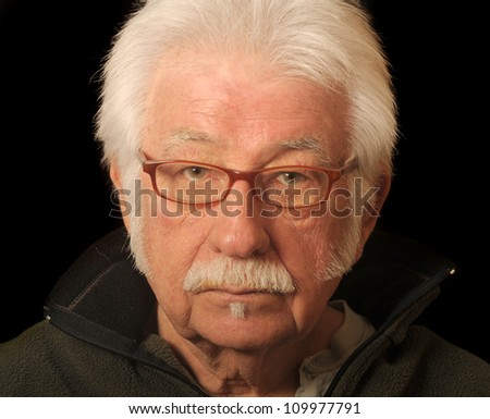 Portrait of an older man wearing glasses - stock photo