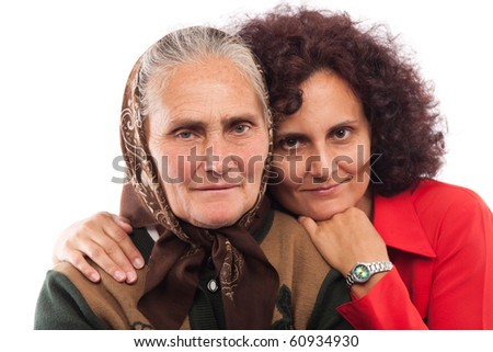 Portrait of an older mother and daughter in studio - stock photo