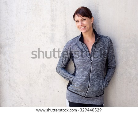 Portrait of an older sports woman smiling - stock photo