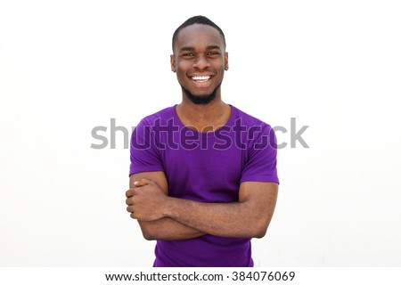 Portrait of an smiling young man in purple t-shirt on white background  - stock photo