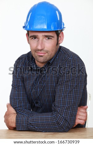 Portrait of an uneasy tradesman - stock photo