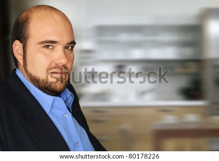 Portrait of an unhappy arrogant executive in modern office setting - stock photo