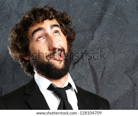 Portrait Of An Unhappy Man against a grunge background - stock photo