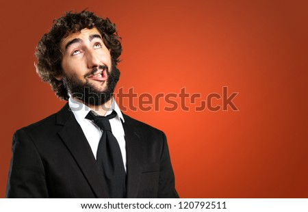 Portrait Of An Unhappy Man against a red background - stock photo