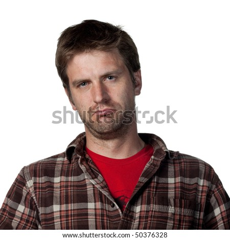 Portrait of an unhappy young man, looking sad - stock photo