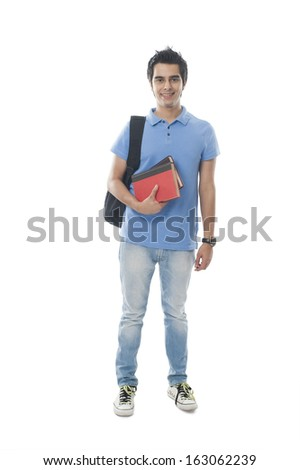 Portrait of an university student holding books and smiling