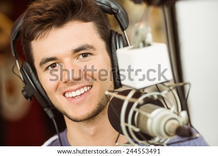 Portrait of an university student recording audio in a studio of a radio - stock photo