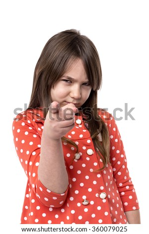 Portrait of an upset  girl accusing with her finger over white background - stock photo