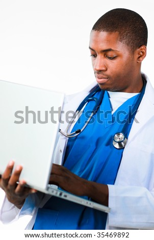 Portrait of an young African doctor working on a laptop isolated against white - stock photo