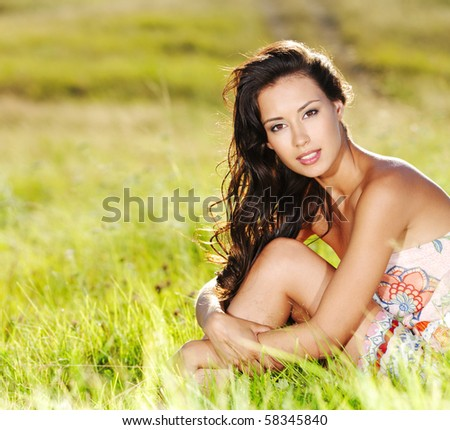 Portrait of an young beautiful sexy woman on the nature - stock photo