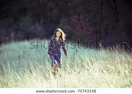 Portrait of an young beautiful woman on the nature - stock photo