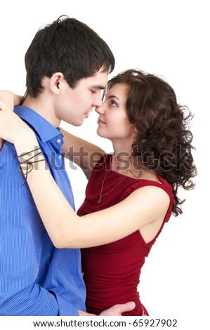 Portrait of an young couple embracing isolated over white background - stock photo