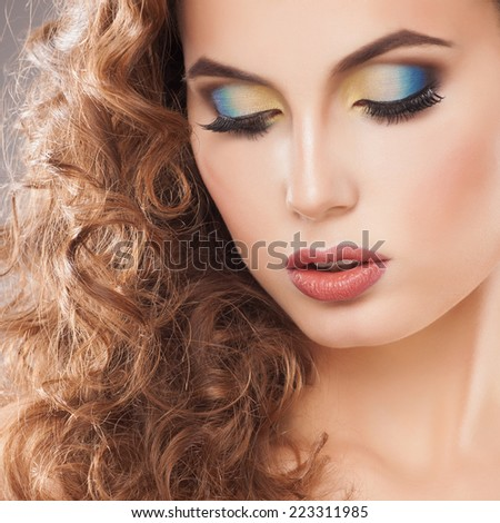 portrait of an young girl with beautiful make-up and curly hair - stock photo
