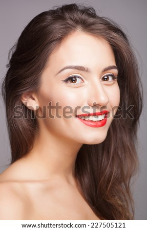 portrait of an young girl with beautiful smile - stock photo