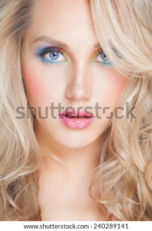 portrait of an young girl with color make-up and beautiful blond hair - stock photo