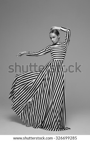 portrait of an young girl with long fashion dress - stock photo