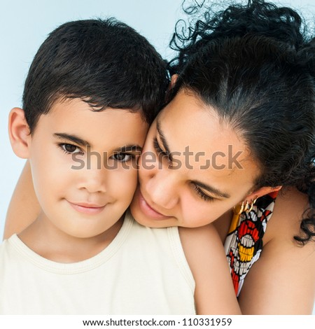 Portrait of an young hispanic woman and her cute son - stock photo